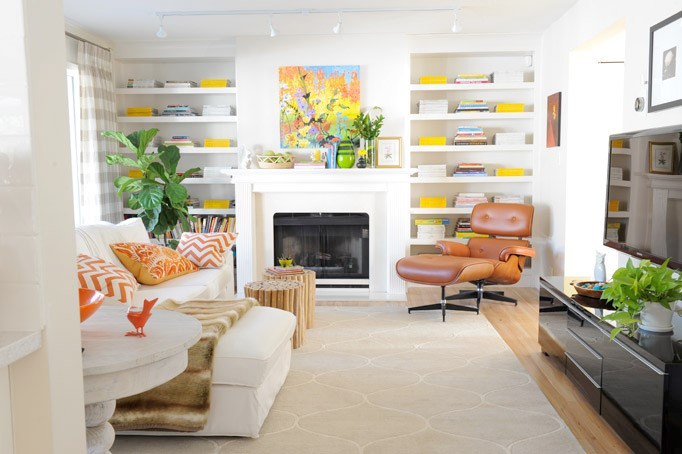 Maria Killam's white family room with orange and green accents