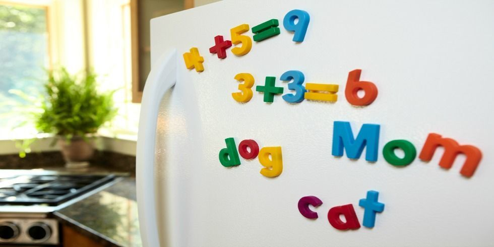 White fridge with Fisher Price refrigerator magnets
