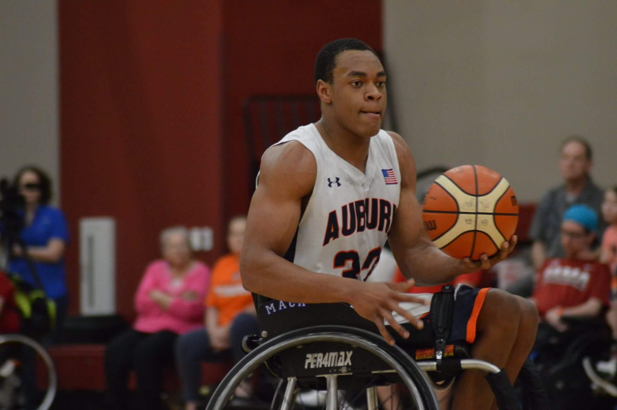 Mackenzie Johnson playing wheelchair basketball at Auburn University